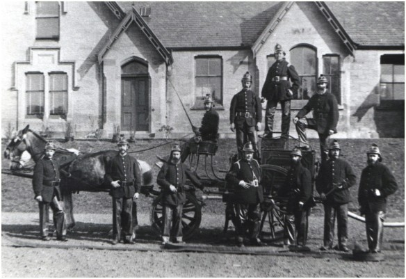 The Auld Fire Engine of Bridge of Allan, Captained by William Cousine (on the very top of the engine)